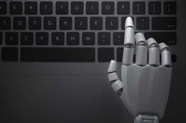 Robot's hand touching a keyboard
