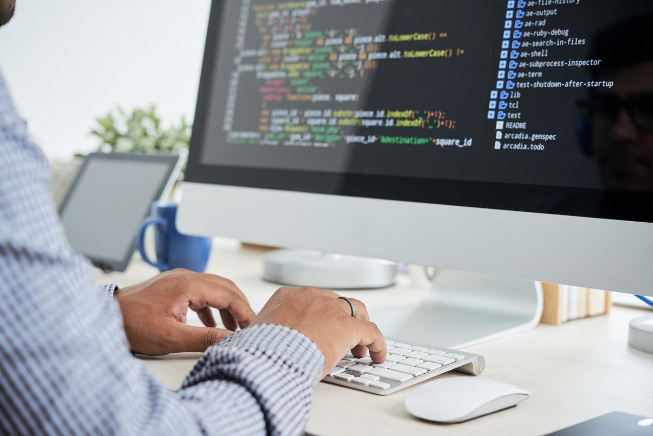 Man writing software code