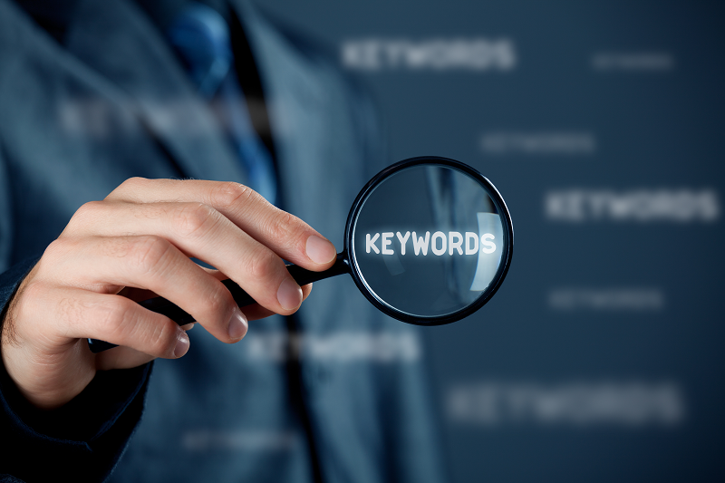 magnifying glass looking at adult keyword research